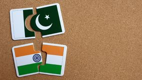 Flags of India and Pakistan. Jigsaw flags of India and Pakistan on cork board. Concepts of Relationship royalty free stock photography