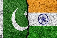 Flags of India and Pakistan painted on cracked wall background/ vector illustration