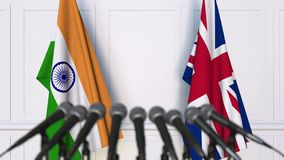 Flags of India and The United Kingdom at international meeting or negotiations press conference. 3D animation stock video