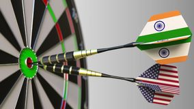 Flags of India and the USA on darts hitting bullseye of the target. International cooperation or competition conceptual. Flags of India and the USA on darts Royalty Free Stock Image