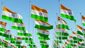 Flags of India waving against clear blue sky. stock footage