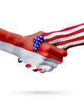 Flags Indonesia and United States countries, overprinted handshake. Flags Indonesia and United States countries, handshake cooperation, partnership and Stock Image