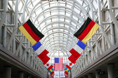 Flags in International Airport. Terminal Stock Photo