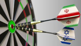 Flags of Iran and Israel on darts hitting bullseye of the target. International cooperation or competition conceptual 3D. Flags of Iran and Israel on darts Royalty Free Stock Image
