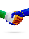 Flags Ireland, European Union countries, partnership friendship handshake concept. Royalty Free Stock Photos