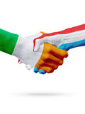 Flags Ireland, Luxembourg countries, partnership friendship handshake concept. Royalty Free Stock Image