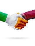 Flags Ireland, Qatar countries, partnership friendship handshake concept. Royalty Free Stock Photo