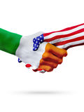 Flags Ireland and United States countries, overprinted handshake. Stock Photo
