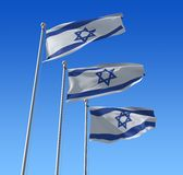 Flags of Israel against blue sky. Stock Photo