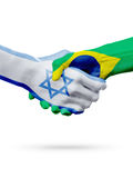 Flags Israel, Brazil countries, partnership friendship handshake concept. Royalty Free Stock Photography