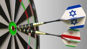 Flags of Israel and Iran on darts hitting bullseye of the target. International cooperation or competition conceptual 3D. Flags of Israel and Iran on darts Royalty Free Stock Photography