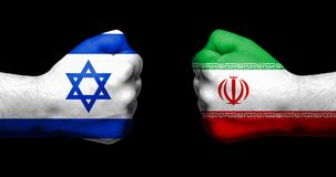 Flags of Israel and Iran painted on two clenched fists facing ea. Ch other on black background/Israel - Iran conflict concept Royalty Free Stock Image