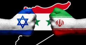 Flags of Israel and Iran painted on two clenched fists facing ea stock photo
