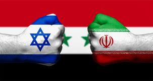 Flags of Israel and Iran painted on two clenched fists facing ea. Ch other with flag of Syria in the background/Israel - Iran conflict concept Stock Image