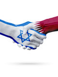 Flags Israel, Qatar countries, partnership friendship handshake concept. Royalty Free Stock Images