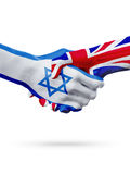 Flags Israel, United Kingdom countries, partnership friendship handshake concept. Stock Photos