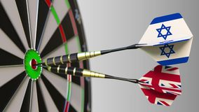 Flags of Israel and the United Kingdom on darts hitting bullseye of the target. International cooperation or competition. Animation stock video