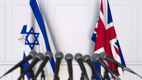 Flags of Israel and The United Kingdom at international meeting or negotiations press conference. 3D animation stock footage