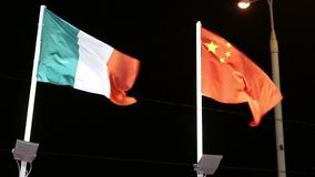 Flags of Italy and China with illumination on wind at night. Flags of Italy and China with illumination on wind at dark night stock footage