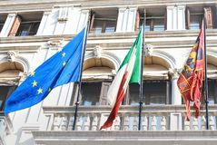 The flags of Italy, the city of Venice and Europian Union fly from a balcony of building in the center of Venice, Italy. Selective focus stock photos