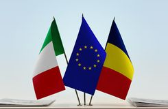 Flags of Italy EU and Chad. Desktop flags of Italy and Chad with European Union flag in the middle royalty free stock image