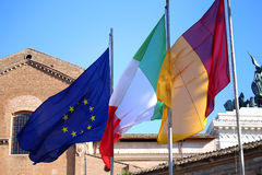 Flags of Italy, European Union and Roma city waving in Rome, Ita Royalty Free Stock Images