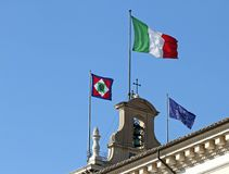 Flags of Italy  on the Quirinal Hill, where houses the President Royalty Free Stock Image