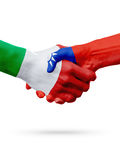 Flags Italy, Taiwan countries, partnership friendship handshake concept. Flags Italy, Taiwan countries, handshake cooperation, partnership, friendship or sports Royalty Free Stock Photography
