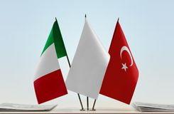 Flags of Italy and Turkey. Desktop flags of Italy and Turkey with white flag in the middle royalty free stock photos