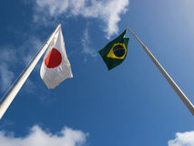 Flags of Japan and Brazil. Fluttering hoisted sky Royalty Free Stock Images