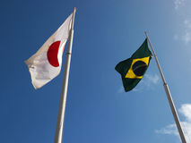 Flags of Japan and Brazil. Fluttering hoisted sky Stock Images