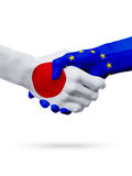 Flags Japan, European Union countries, partnership friendship handshake concept. Royalty Free Stock Images