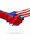 Flags Kingdom Cambodia and United States countries, overprinted handshake. Stock Image