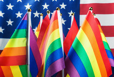 Flags of the LGBT community. On a background of the American flag Stock Photo