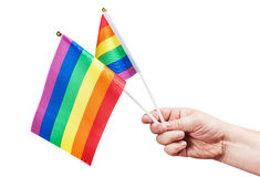 Flags of the LGBT community in a hand isolated Stock Image