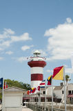 Flags and lighthouse Royalty Free Stock Photography