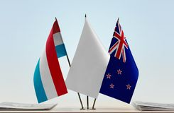 Flags of Luxembourg and New Zealand Royalty Free Stock Photo