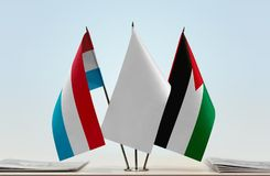 Flags of Luxembourg and Palestine Royalty Free Stock Photography