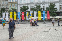Flags on the main market square in Krakow Royalty Free Stock Photography