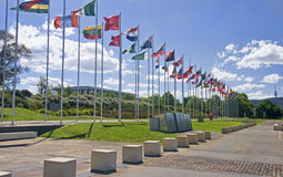 Flags on the main pedestrian walking on the lake in the center o Royalty Free Stock Photo