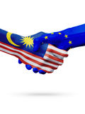 Flags Malaysia, European Union countries, partnership friendship handshake concept. Royalty Free Stock Image