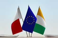 Flags of Malta EU and Ivory Coast. Desktop flags of Malta and Ivory Coast with European Union flag in the middle Stock Photo