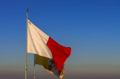 Flags of Malta and Vatican. Flags of the Republic of Malta and the Vatican City State waving in the wind Royalty Free Stock Photo