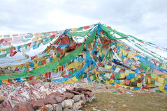 The flags and Manis. Tibetan buddhist mountain worship cetemory Stock Image