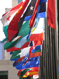 Flags of many colors. Flown in Rockefeller Plaza, New York City Stock Photos