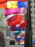 Flags of many colors. Flown in Rockefeller Plaza, New York City Royalty Free Stock Image