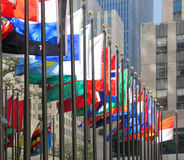 Flags of many colors. Flown in Rockefeller Plaza, New York City Stock Photography