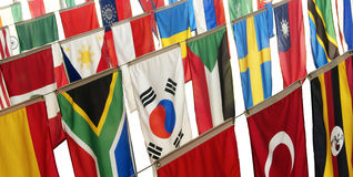 Flags of many countries. Hang vertically, representing a host of ethnic diversity from many cultures Royalty Free Stock Photos