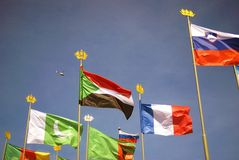 Flags of many countries. Blue sky background. Royalty Free Stock Photography