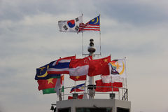 Flags of many countries on a ship to Namiseom or Namisum or Nam. I Island, a famous tourist attraction in South Korea Royalty Free Stock Photography